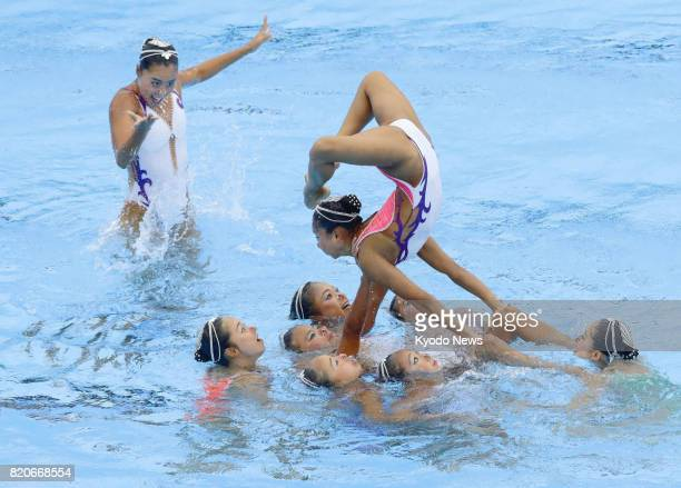 Japanese synchronized swimmers perform in the final round of the team free combination event at the FINA World Championships in Budapest on July 22...