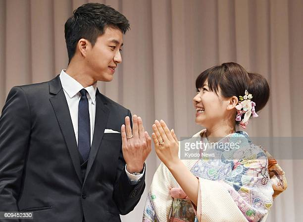 Japanese table tennis icon Ai Fukuhara and her Taiwanese husband Chiang Hungchieh also a table tennis player attend a press conference in Tokyo on...