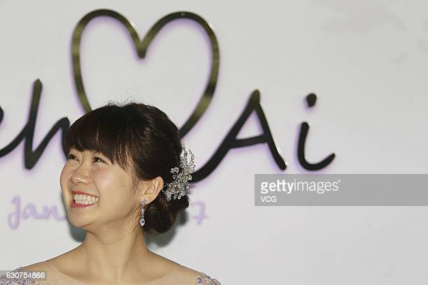Japanese table tennis player Ai Fukuhara meets media with her husband Taiwanese table tennis player Chiang Hungchieh during their wedding ceremony on...