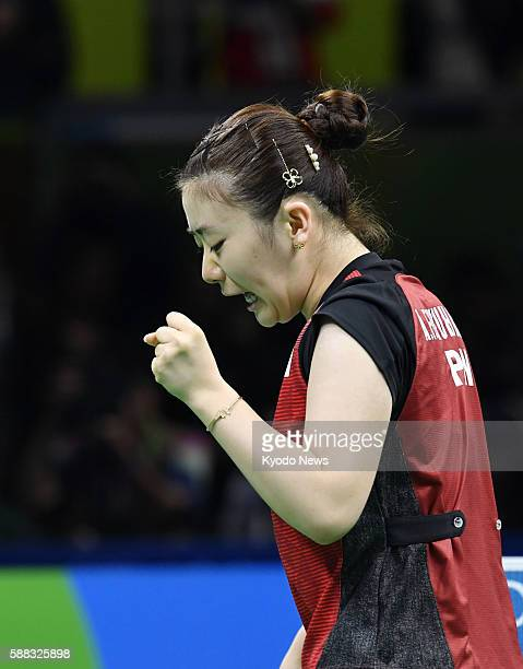 Japanese table tennis player Ai Fukuhara pumps her fist after winning a point in her singles bronze medal match against North Korea's Kim Song I at...