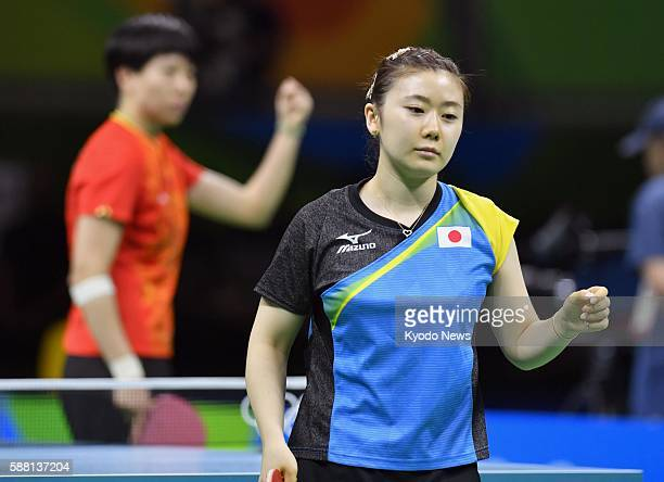 Japanese table tennis player Ai Fukuhara reacts after losing a point in her singles semifinal match against defending Olympic champion Li Xiaoxia of...