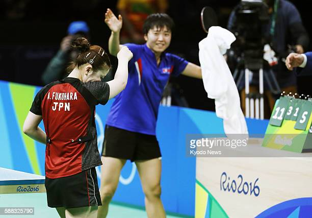 Japanese table tennis player Ai Fukuhara reacts after losing her singles bronze medal match against North Korea's Kim Song I at the Rio Olympics on...