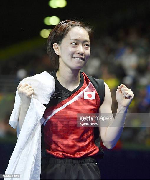 Japanese table tennis player Kasumi Ishikawa reacts after defeating Feng Tianwei of Singapore in a women's table tennis team bronze medal match at...