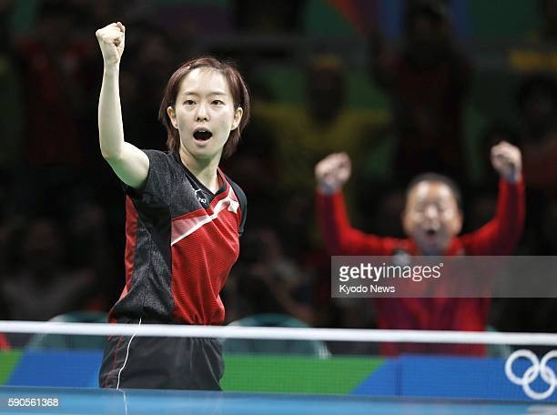 Japanese table tennis player Kasumi Ishikawa reacts after taking the first game of her match against Feng Tianwei of Singapore in the women's table...