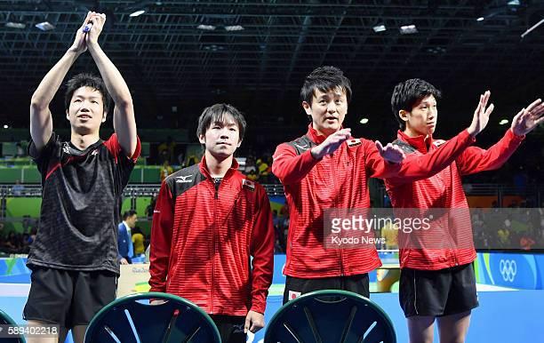 Japanese table tennis players Jun Mizutani Koki Niwa and Maharu Yoshimura acknowledge the spectators alongside coach Yosuke Kurashima after beating...