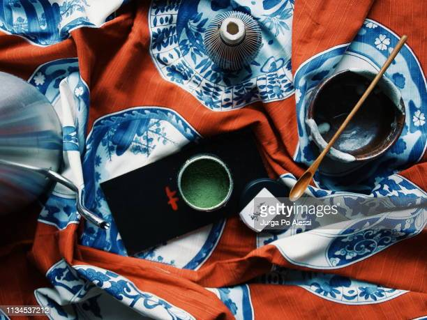 japanese tea ceremony set, high angle view on a coloured background. - ceremony stock pictures, royalty-free photos & images
