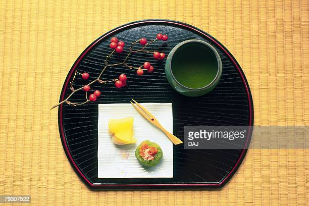 A Japanese tea cup and sweets on a tray, Close Up