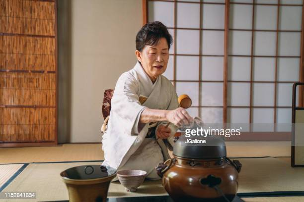 japanese tea master making a cup of matcha tea - showing respect stock pictures, royalty-free photos & images
