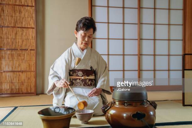 japanese tea master making a cup of traditional matcha tea - ceremony stock pictures, royalty-free photos & images