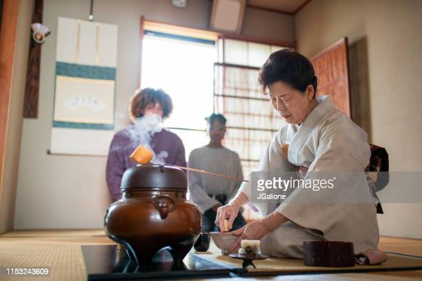japanese tea master whisking matcha tea - ceremony stock pictures, royalty-free photos & images