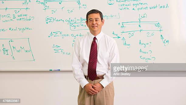 Japanese teacher standing in front of whiteboard