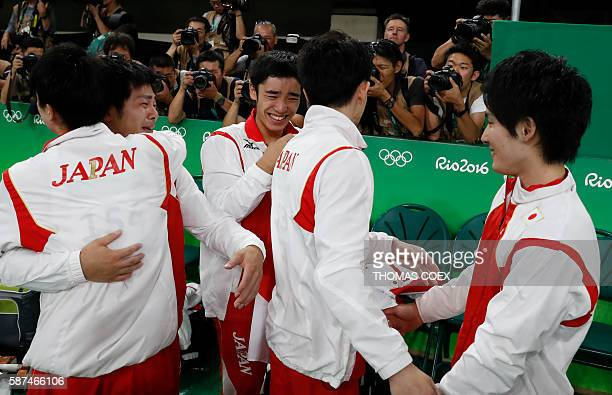 TOPSHOT Japanese team celebrate after winning the men's team final of the Artistic Gymnastics at the Olympic Arena during the Rio 2016 Olympic Games...