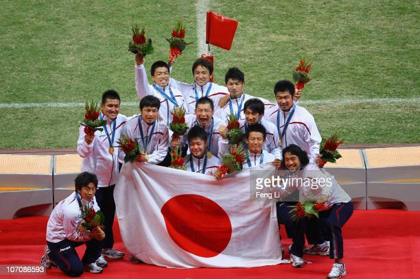 Japanese team celebrate winning in the Men's Gold Medal Match at University Town Main Stadium during day eleven of the 16th Asian Games Guangzhou...