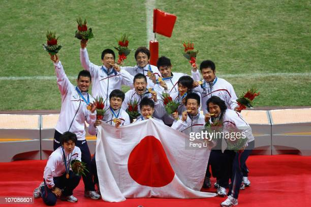 Japanese team celebrate winning in the men's gold medal match of rugby at University Town Main Stadium during day eleven of the 16th Asian Games...