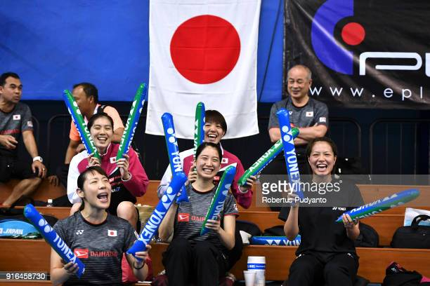 Japanese team members cheer during Women's Team Semifinal match between Japan and Indonesia in the EPlus Badminton Asia Team Championships 2018 at...