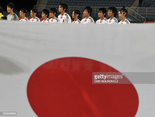Japanese team players listen to the national anthem before the FIFA Women's Under17 semifinal match against North Korea on September 21 at the Ato...