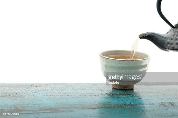 Japanese teapot tetsubin and cup, isolated, white background, copy space
