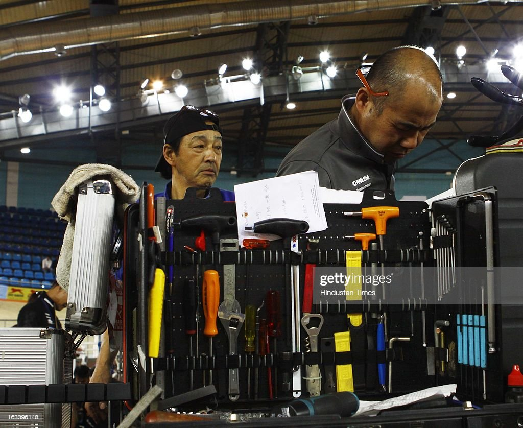 Japanese technicians works on the cycles on a proper stand with ultra modern equipments cost around 05 lakhs rupees in compeer of Indian contingents who works with mere equipments of Thousands rupees during Asian Cycling Championship at IG Cycling Velodrome on March 8, 2013 in New Delhi, India.