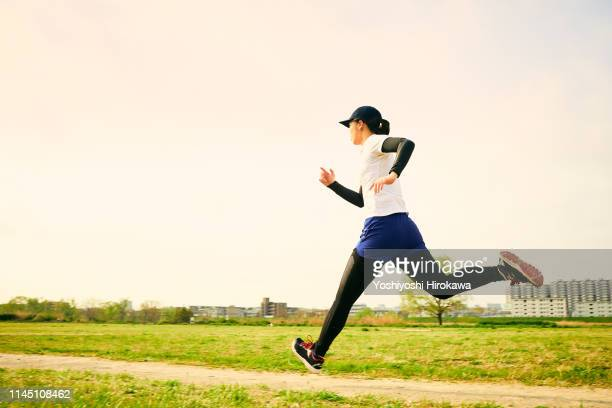 japanese teen women are running in preparation for exercise - 走る ストックフォトと画像
