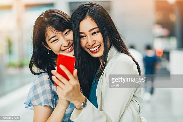 japanese teenage girls with smart phone - beautiful japanese girls stock photos and pictures