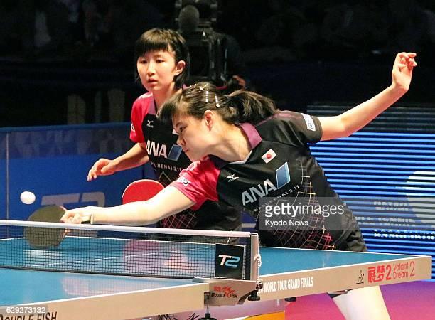 Japanese teenagers Yui Hamamoto and Hina Hayata play against Doo Hoi Kem and Lee Ho Ching of Hong Kong during the women's doubles final at the table...
