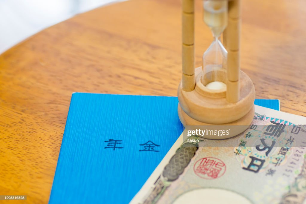 Japanese Ten Thousand Yen Note, Pension Book And Hourglass : Stock Photo
