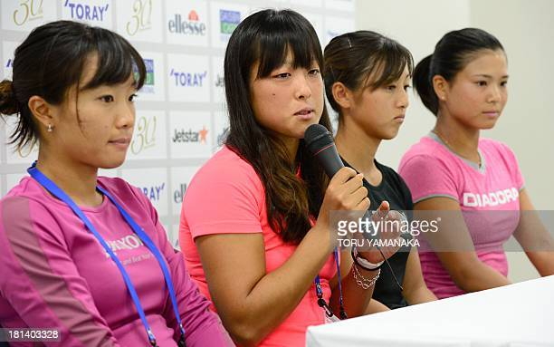 Japanese tennis player Ayumi Morita answers questions while her compatriots Kurumi Nara Misaki Doi and Risa Ozaki look on during a press conference...