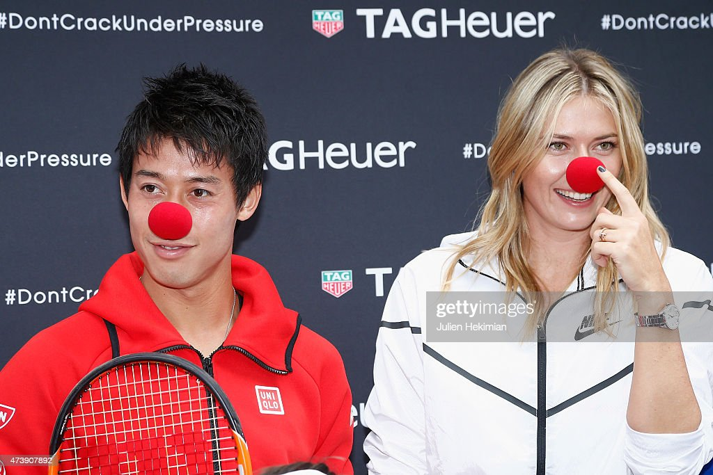 Japanese tennis player Kei Nishikori and Russian tennis player Maria Sharapova pose with a red nose to support the Association Theodora fund event organized by Tag Heuer on May 18, 2015 in Paris, France.