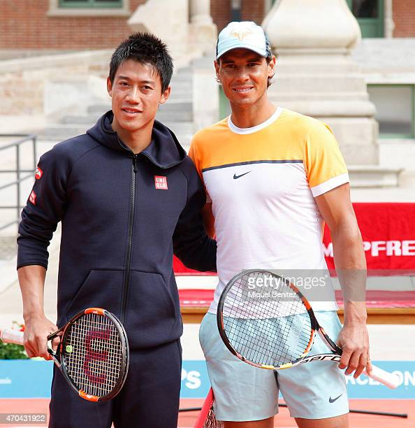 Japanese tennis player Kei Nishikori and Spanish tennis player Rafael Nadal pose for a photo at the Sant Pau Hospital in Barcelona during day one of...