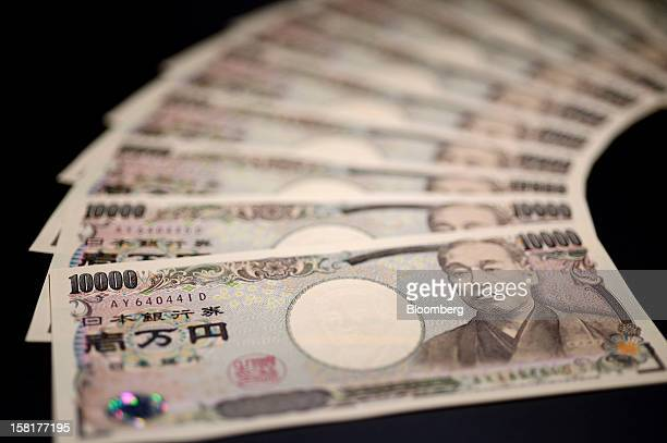 Japanese tenthousand yen banknotes are arranged for a photograph in Kawasaki Kanagawa Prefecture Japan on Monday Dec 10 2012 The yen is losing its...