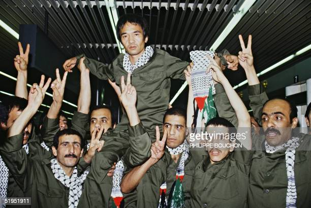 Japanese terrorist Kozo Okamoto member of Japanese guerrilla group Red Army is carried on the shoulders of his former Palestinian jail companions as...