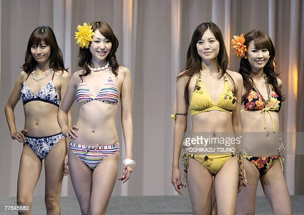 Japanese textile giant Toray's new campaign girl Aoi Nakabeppu a 17yearold high school girl and other models show off Toray's swimsuits for the next...