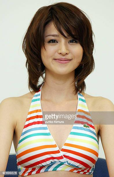 Japanese textile maker Toray's new campaign girl Chinami Suzuki models their latest swimwear during a press conference at their headquarters on...