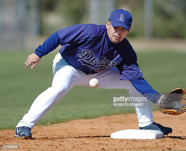 Japanese third baseman Norihiro Nakamura fields the ball on his first day of practice with the Los Angeles Dodgers at their Vero Beach Florida spring...