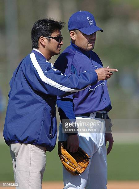 Japanese third baseman Norihiro Nakamura listens to a translator on his first day of practice with the Los Angeles Dodgers at their Vero Beach...