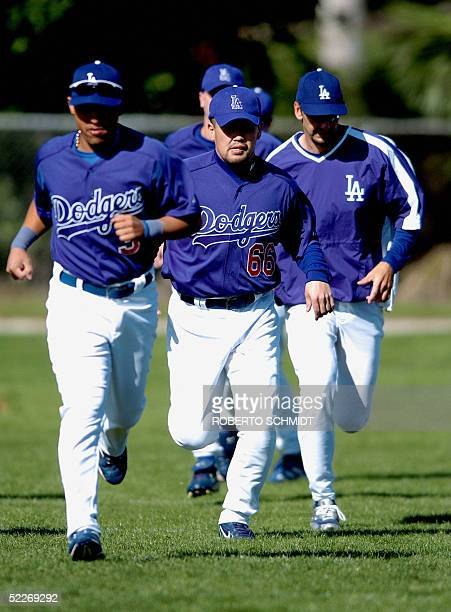 Japanese third baseman Norihiro Nakamura runs with teammates on his first day of practice with the Los Angeles Dodgers at their Vero Beach Florida...