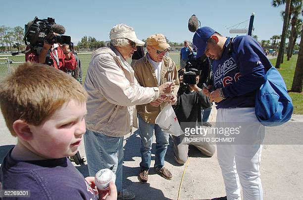 Japanese third baseman Norihiro Nakamura signs autographs during his first day of practice with the Los Angeles Dodgers at their Vero Beach Florida...