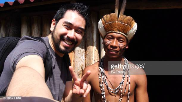 Japanese Tourist Taking a Selfie with Indigenous Brazilian Man, from Guarani ethnicity