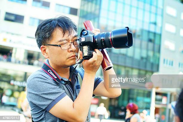 japanese tourist taking pictures. - zagreb stock pictures, royalty-free photos & images