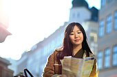 japanese tourist woman using city map