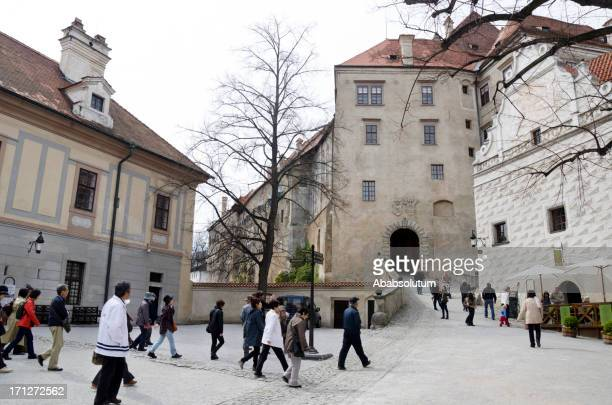 japanese tourists in česky krumlov europe - cesky krumlov castle stock photos and pictures