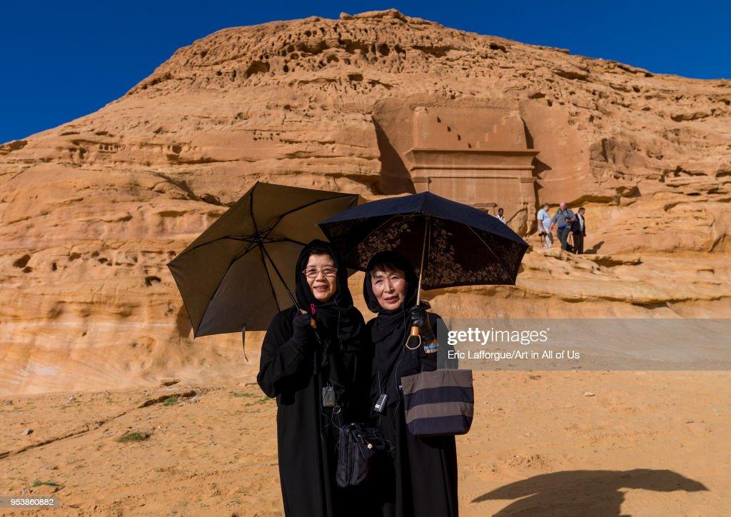 Japanese tourists in front of a nabataean tomb in madain saleh archaeologic site, Al Madinah Province, Al-Ula, Saudi Arabia... : News Photo