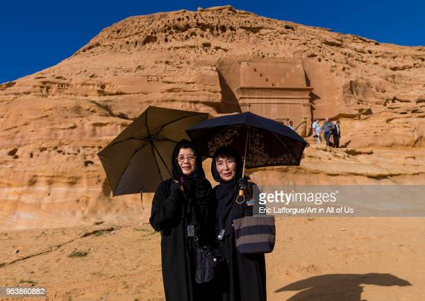 Japanese tourists in front of a nabataean tomb in madain saleh archaeologic site Al Madinah Province AlUla Saudi Arabia on January 23 2010 in Alula...