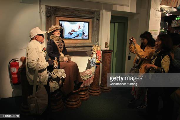 Japanese tourists take holiday photographs at The World of Beatrix Potter attraction on June 1, 2011 in Windermere, United Kingdom. The English Lake...