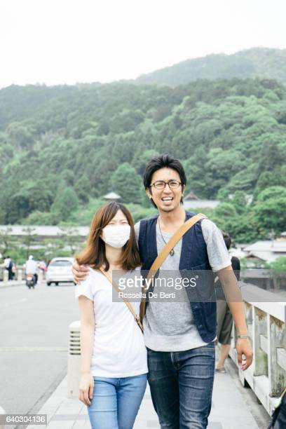 japanese tourists walking in the countryside - flu mask stock photos and pictures
