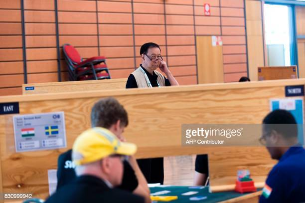 Japanese Tournament Director Anthony Ching supervises the players who compete in the 43rd World Bridge Championships in Lyon on August 13 2017 / AFP...