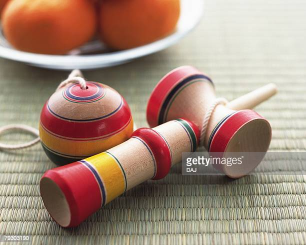 Japanese toy (Kendama) on Tatami mat, high angle view, differential focus