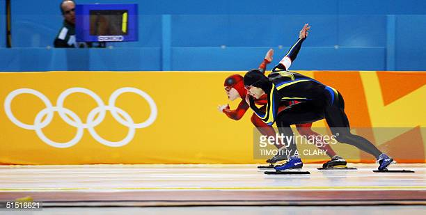 Japanese Toyoki Takeda and Canadian Mike Ireland skate in the first men's 500m speed skating race at the Utah Olympic Oval 11 February 2002 during...