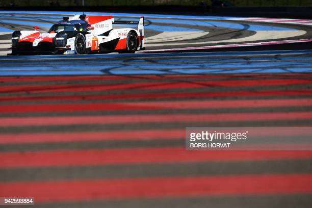 TOPSHOT Japanese Toyota Gazoo Racing's Sebastien Buemi Mike Conway Alexander Wurz and Jose Maria Lopez drive the new Toyota TS050 Hybrid during the...