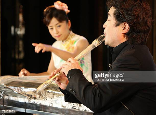 Japanese traditional bamboo flute or shakuhachi player Gazan Watanabe plays a glassmade shakuhachi as Wu Fang plays a glassmade Chinese koto during a...